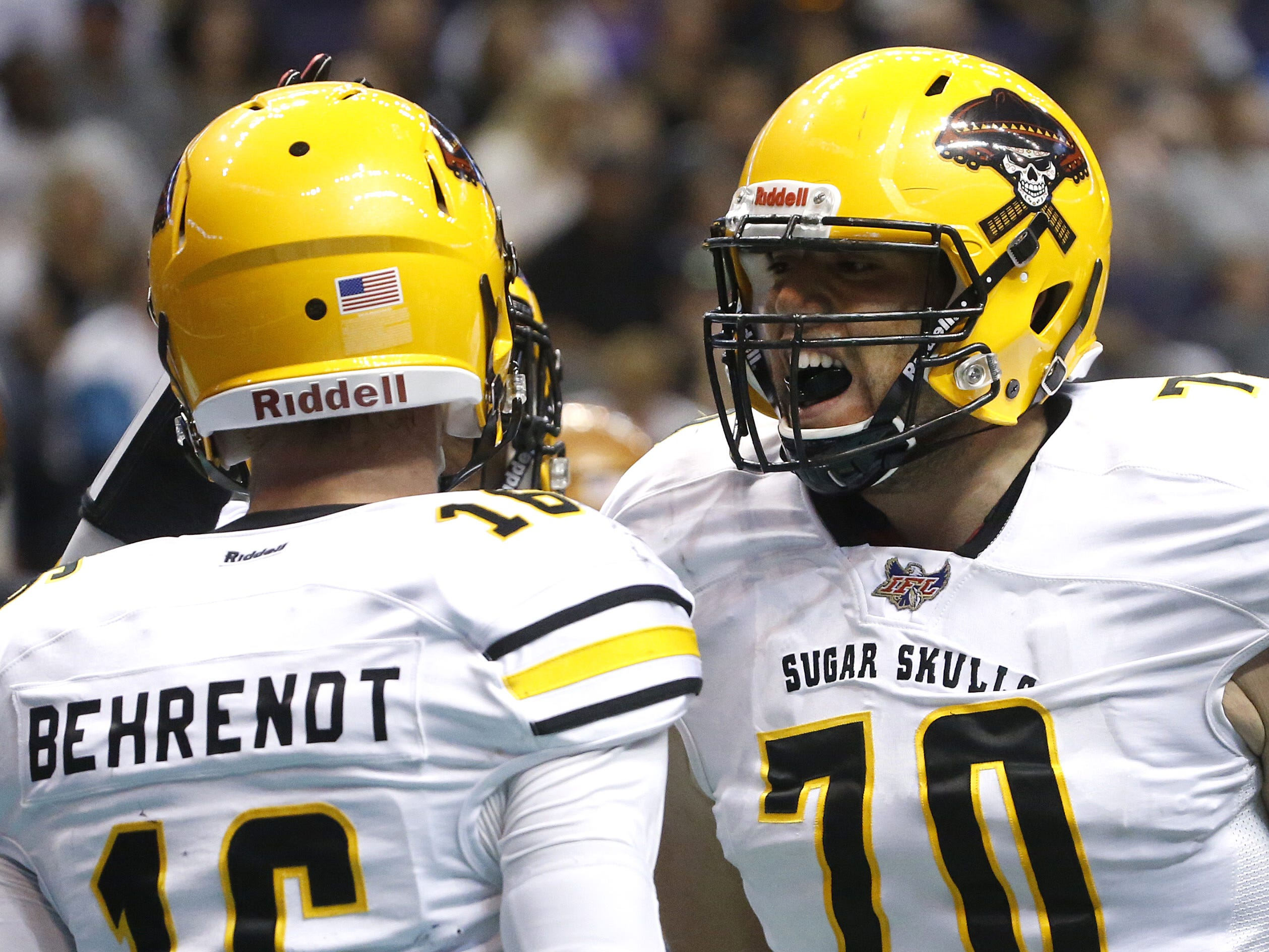 Sugar Skulls' Matt Behrendt (16) celebrates with teammate Alex Rios (70) after he scrambled for a touchdown during the first half at Talking Stick Resort Arena in Phoenix, Ariz. on March 16, 2019.