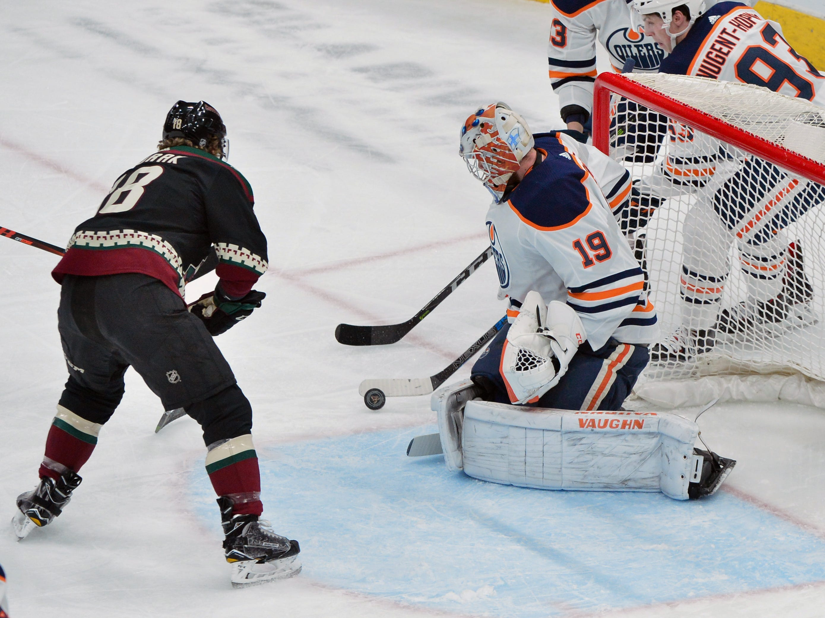 Mar 16, 2019; Glendale, AZ, USA; Edmonton Oilers goaltender Mikko Koskinen (19) makes a save against Arizona Coyotes center Christian Dvorak (18) during the first period at Gila River Arena.