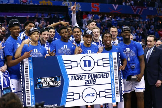 Mar 16, 2019; Charlotte, NC, USA; The Duke Blue Devils celebrate after after defeating the Florida State Seminoles in the ACC conference tournament at Spectrum Center. Mandatory Credit: Jeremy Brevard-USA TODAY Sports