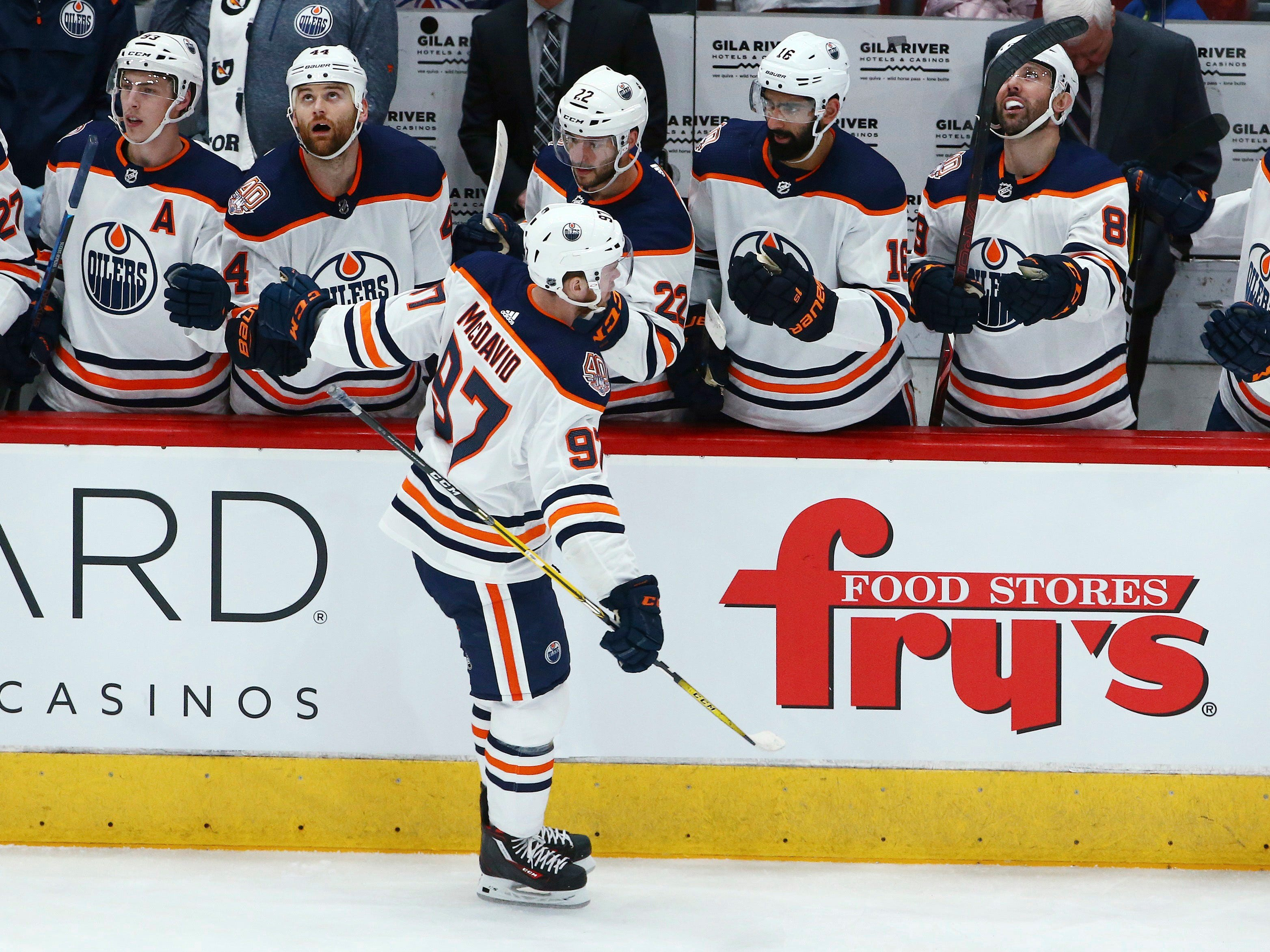 Edmonton Oilers center Connor McDavid (97) celebrates his goal against the Arizona Coyotes during the first period of an NHL hockey game Saturday, March 16, 2019, in Glendale, Ariz.