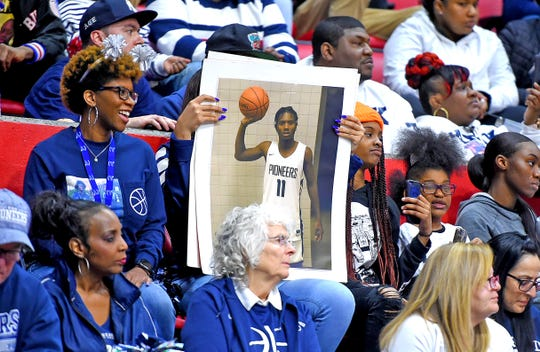 Poughkeepsie fans hold up poster with photo of senior Jamar Campbell during the state boys basketball final in Binghamton on March 16.