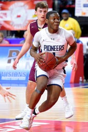 Poughkeepsie's Jamik Carter drives to the basket against Pittsford Mendon, during the state Class A Championship at Floyd L. Maines Veterans Memorial Arena in Binghamton on Saturday.