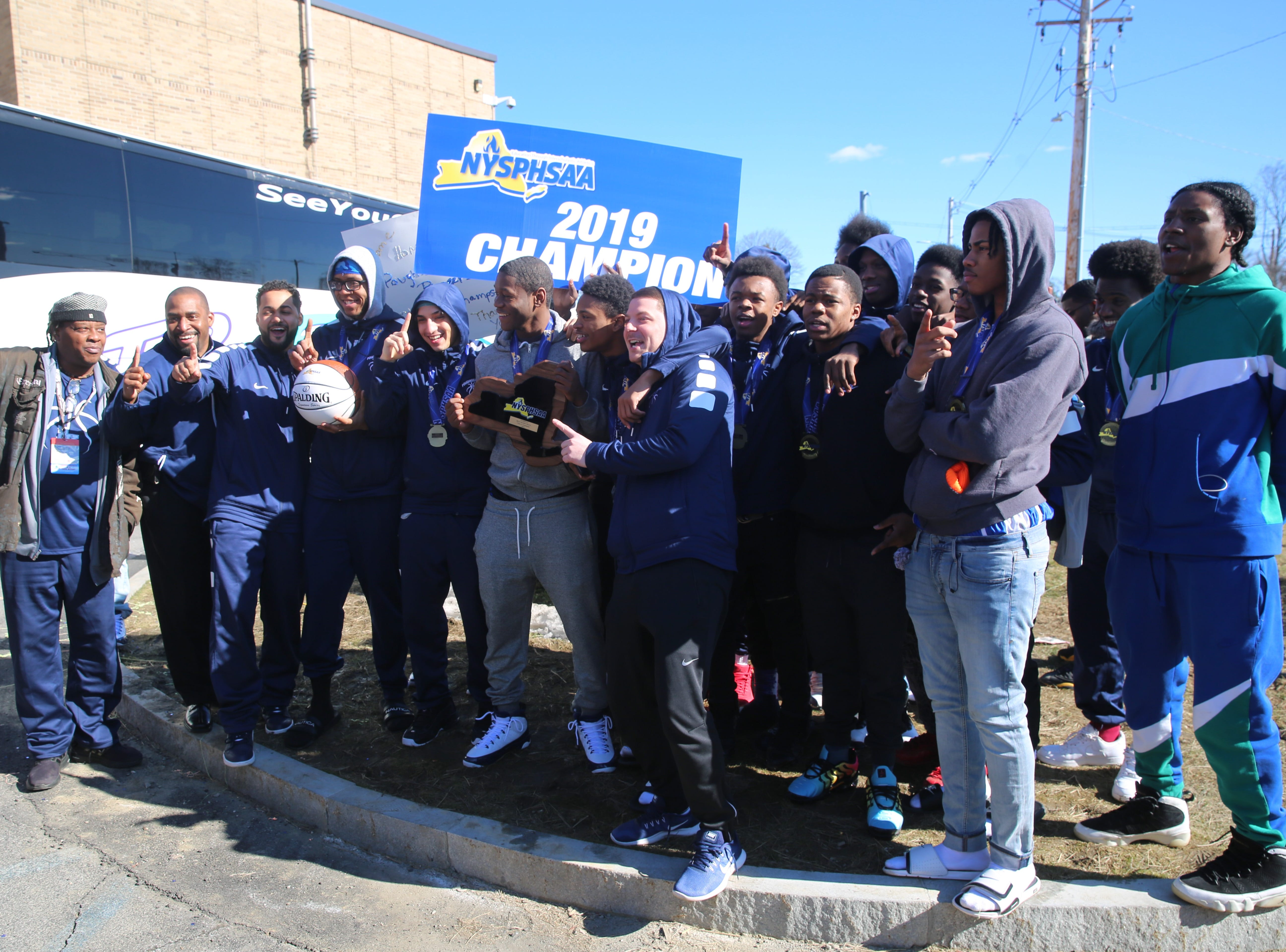 A scene from the celebration at Poughkeepsie High School on Sunday welcoming back members of the boys basketball team who captured the school's first state title since 1995 on Saturday night.