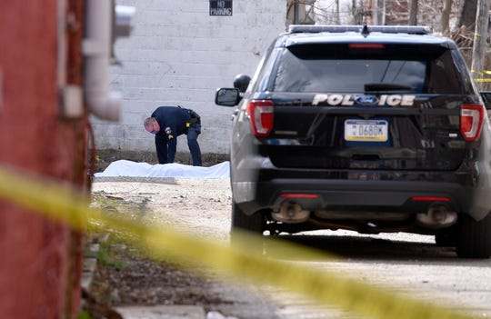 York City Police investigate a fatal shooting on Light Ave. between W. King St. and W. Poplar Ave., Sunday, March 18, 2018.