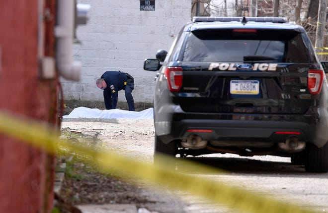 York City Police investigate a fatal shooting on Light Ave. between W. King St. and W. Poplar Ave., Sunday, March 18, 2018.John A. Pavoncello photo