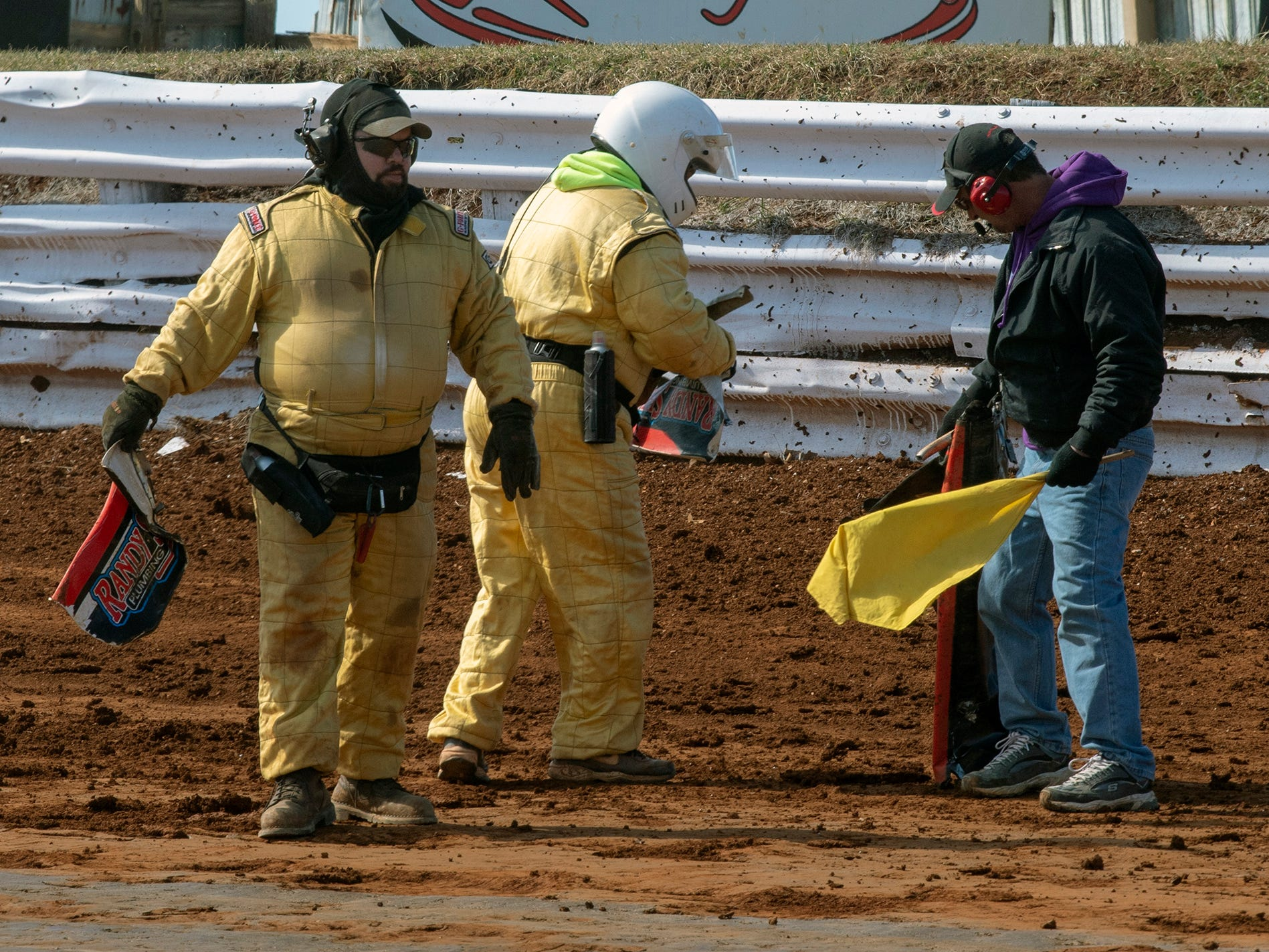 The track crew picks up pieces of a car after the yellow warning flag during the Williams Grove season opener for 410 sprints Sunday March 17, 2019.
