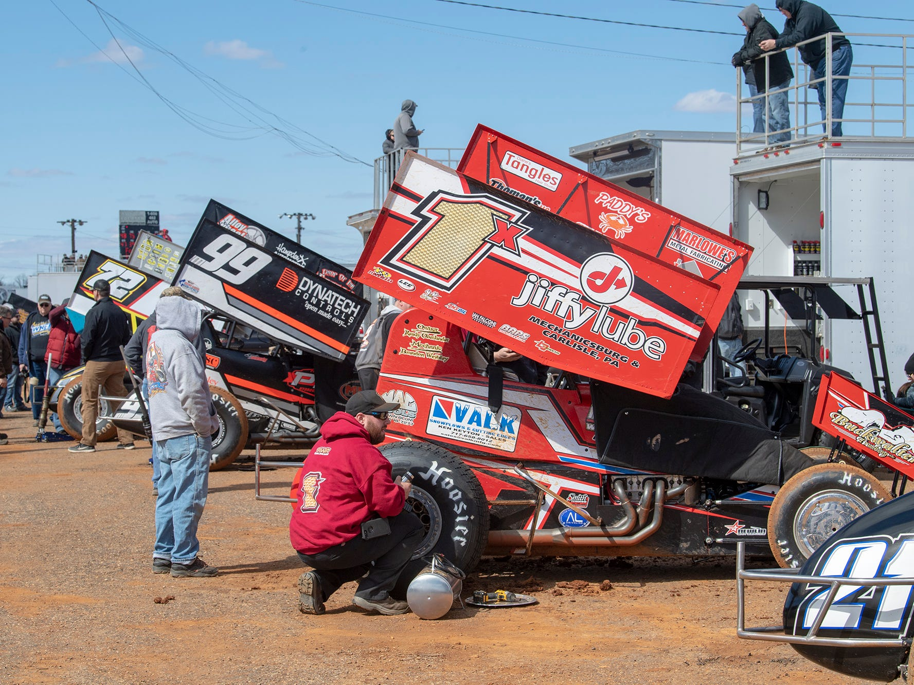 Pit crews work before the Williams Grove season opener for 410 sprints Sunday March 17, 2019.