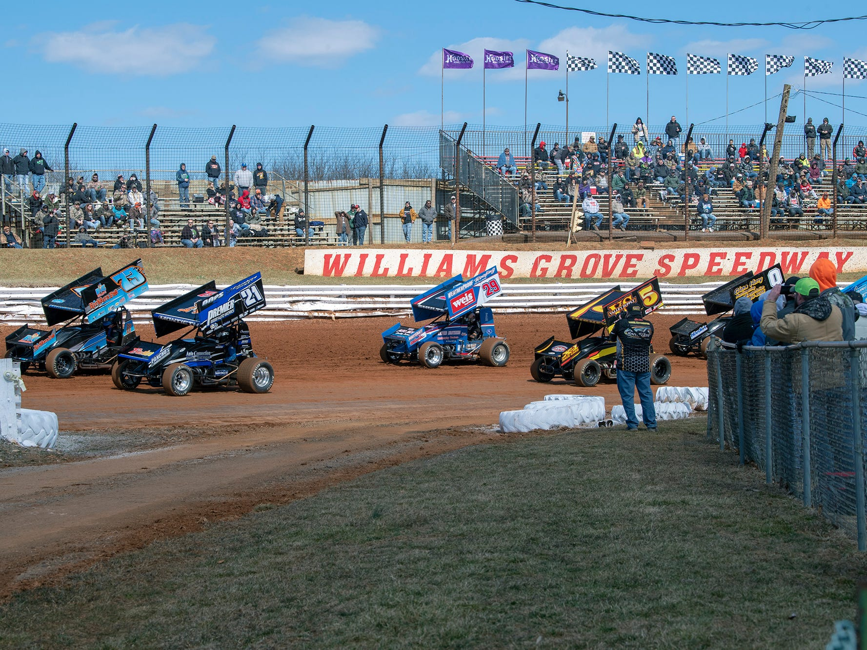 Cars round the track warming up for the Williams Grove season opener for 410 sprints Sunday March 17, 2019.