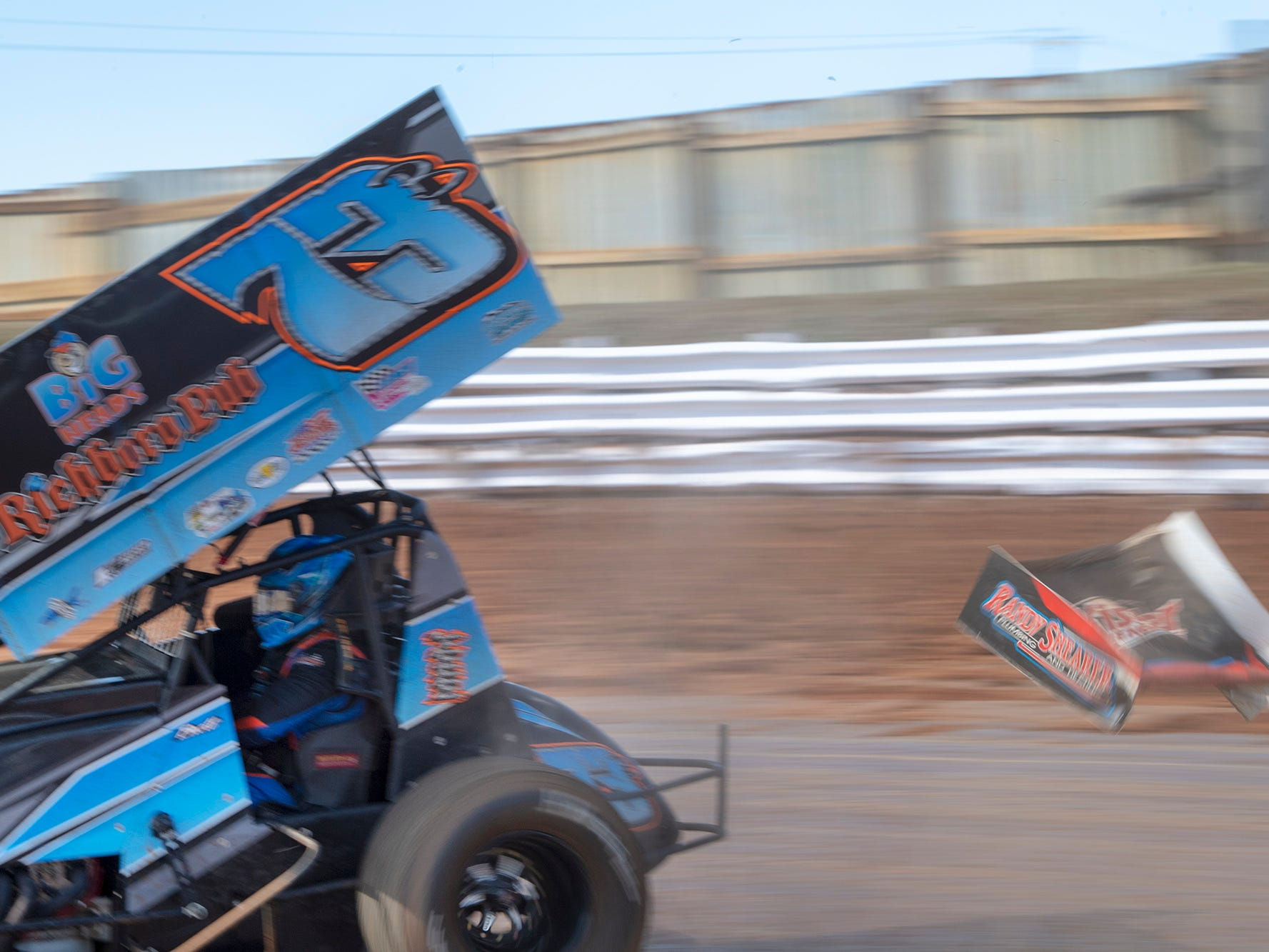A piece of another car flies by the #73 car driven by Brett Michalski after collision in a turn during the Williams Grove season opener for 410 sprints Sunday March 17, 2019.