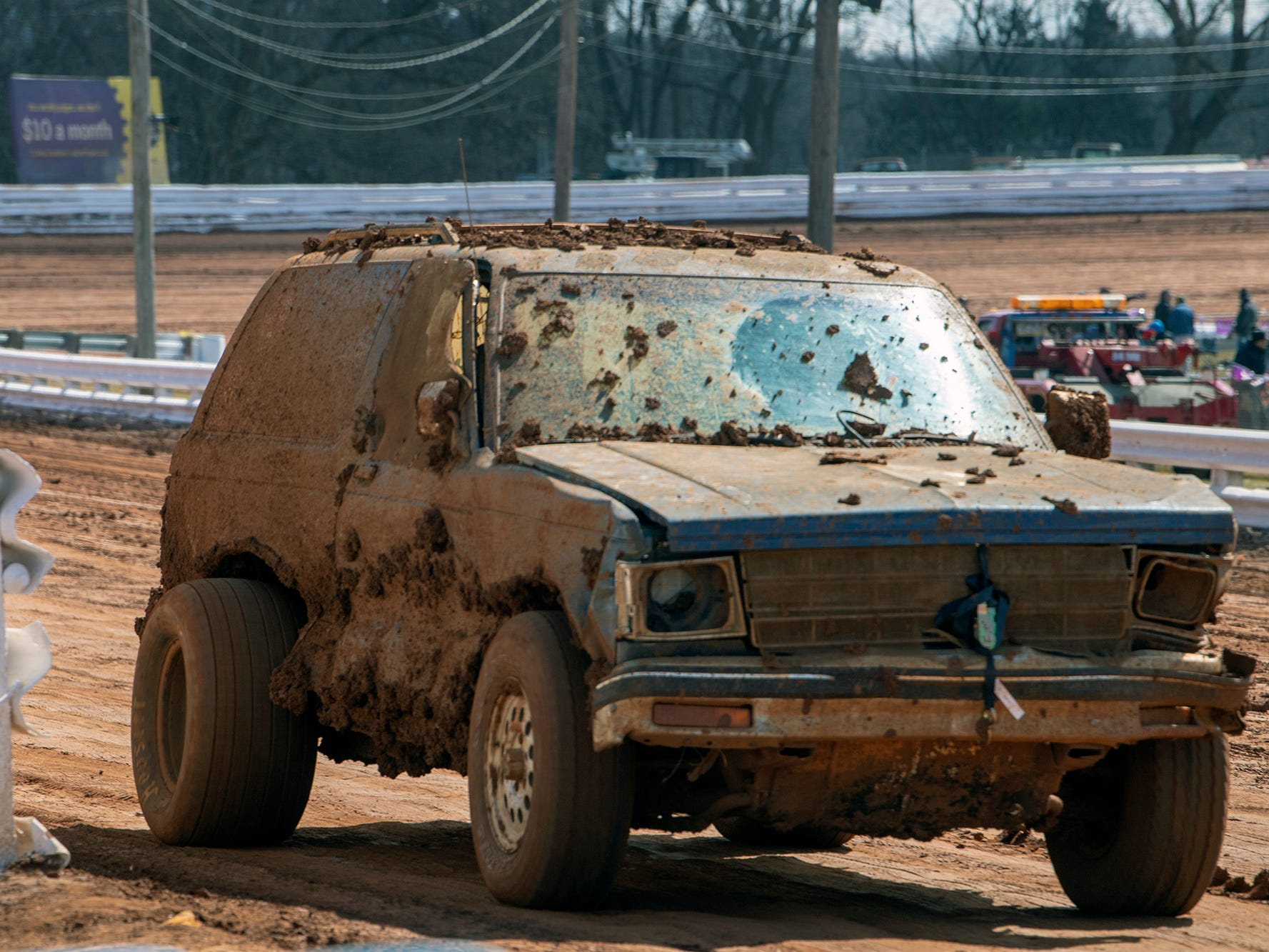 A mud slogged vehicle with fat tires makes laps to condition the clay track before the Williams Grove season opener for 410 sprints Sunday March 17, 2019.