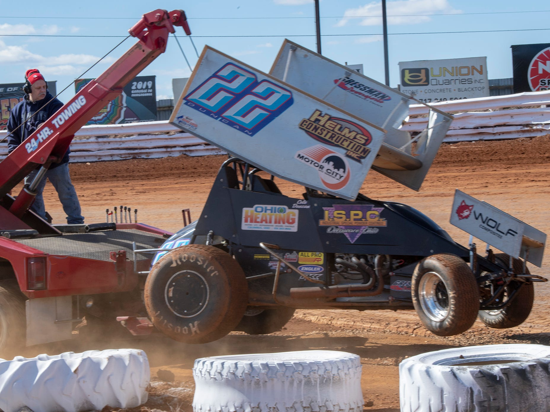 The #22 car driven by Cole Duncan is towed from the track during the Williams Grove season opener for 410 sprints Sunday March 17, 2019.