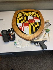 This handgun, drugs and paraphernalia were seized by Maryland State Police in a Saturday arrest of a man and two women, all from Pennsylvania.