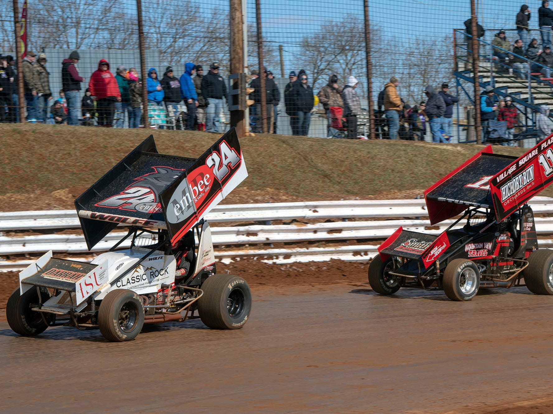 The #24 car driven by Lucus Wolfe and the the #11 car driven by TJ Stutts pass fans on the back stretch during Williams Grove season opener for 410 sprints Sunday March 17, 2019.