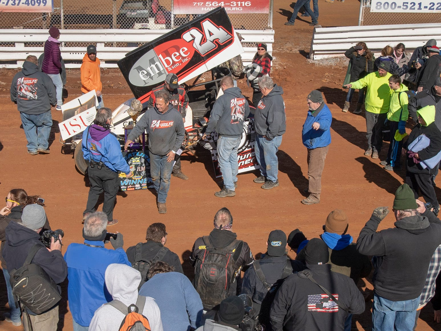 Media and fans surround the #24 car after Lucas Wolfe won the feature event during the Williams Grove season opener for 410 sprints Sunday March 17, 2019.