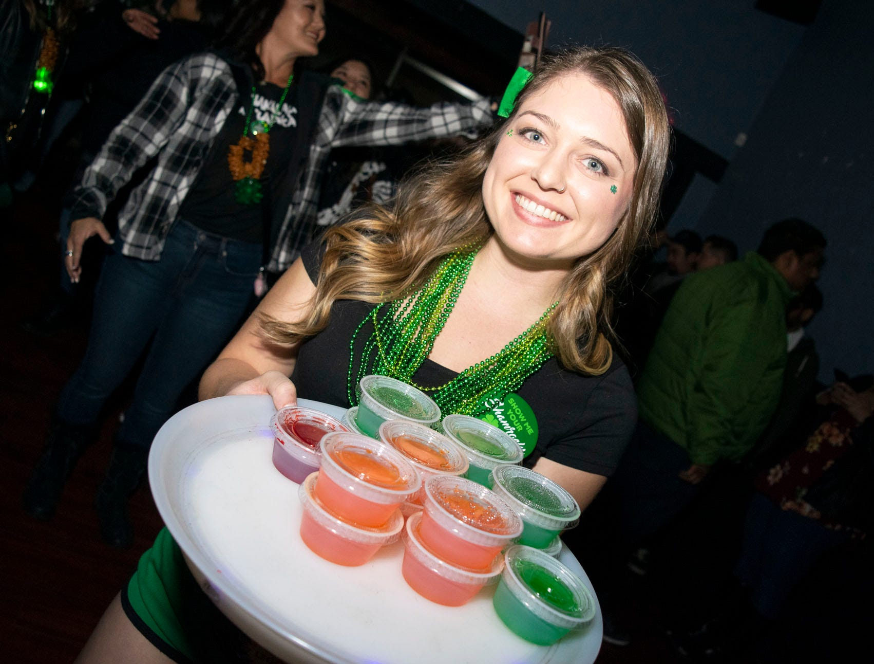 Mikayla Rankin serves jello shots at the Library Bar during the 2019 Leprechaun Crawl on Saturday, March 16, 2019. Reno, Nev.
