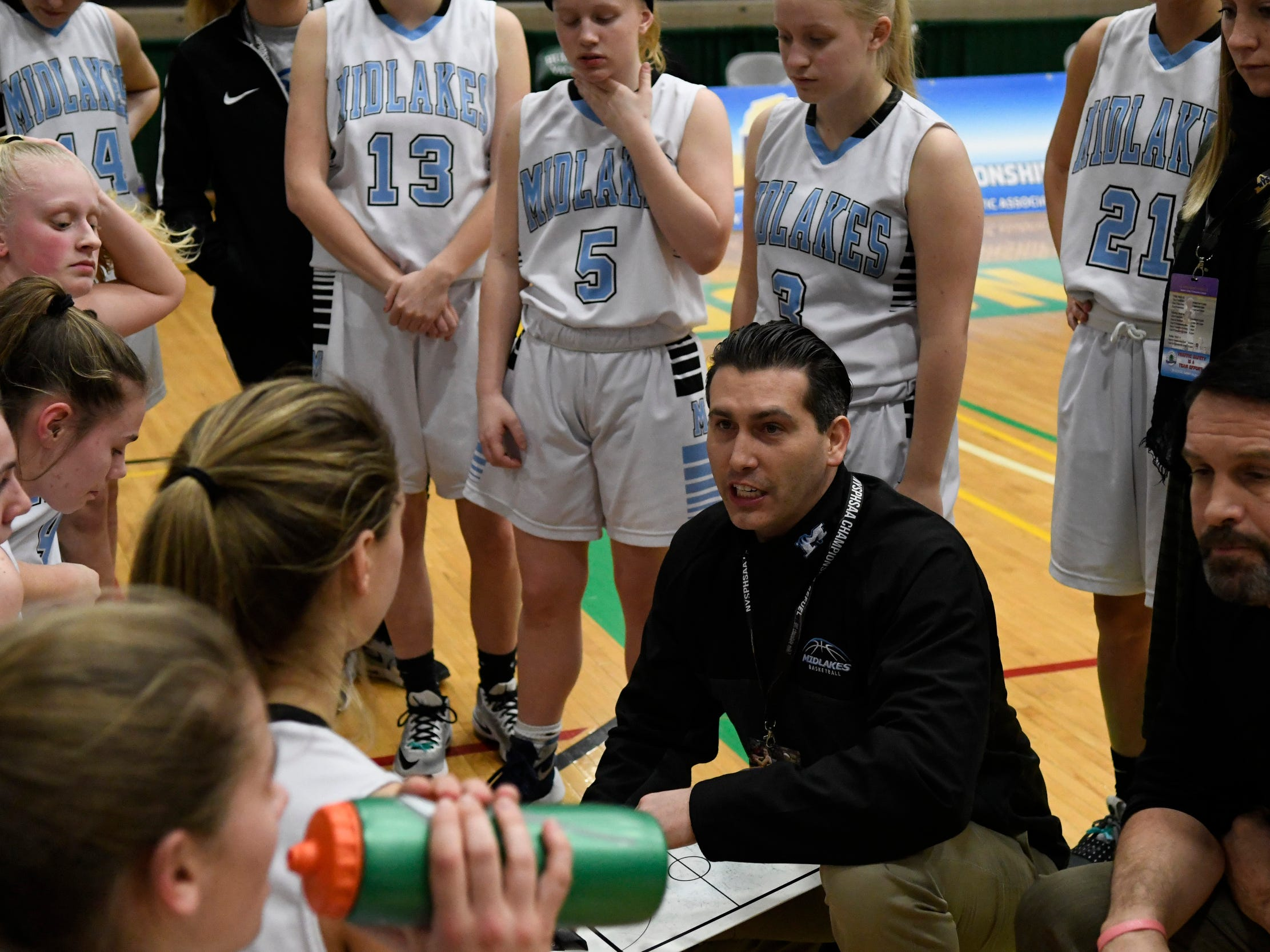 Midlakes girls basketball coach Nate Rich speaks to his players between quarters of the Class B State Championship against Irvington at Hudson Valley Community College on March 16, 2019, in Troy, N.Y.