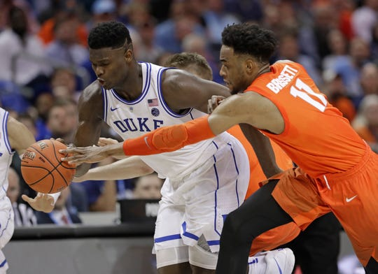 Duke's Zion Williamson, left, steals the ball from Syracuse's Oshae Brissett, right, during the second half of an NCAA college basketball game in the Atlantic Coast Conference tournament in Charlotte, N.C., Thursday, March 14, 2019. (AP Photo/Chuck Burton)