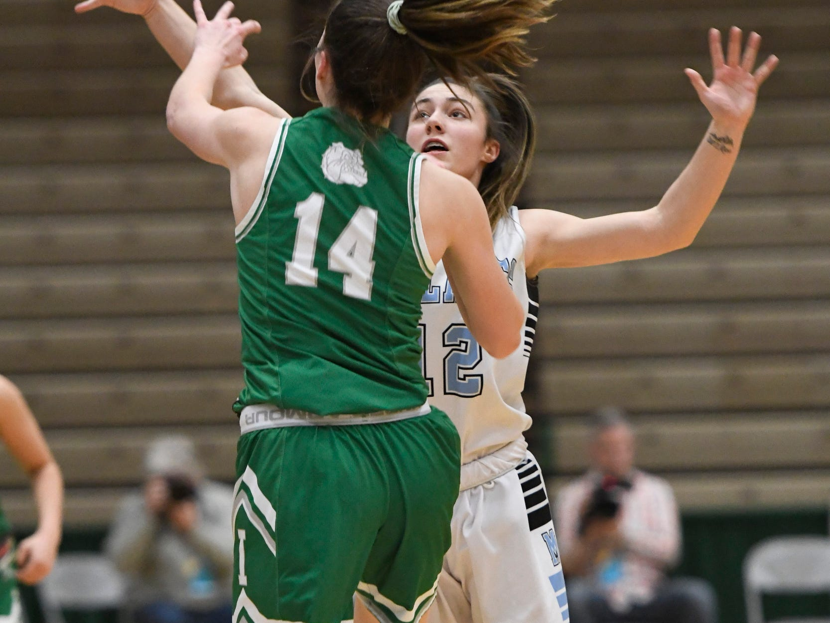 Midlakes' Alaina Forbes knocks a ball away from Irvington's Mia Mascone during the Class B State Championship at Hudson Valley Community College on March 16, 2019, in Troy, N.Y.