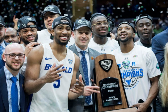 Mar 16, 2019; Cleveland, OH, USA; The Buffalo Bulls pose with the MAC trophy after winning the MAC conference tournament championship game against the Bowling Green Falcons at Quicken Loans Arena.