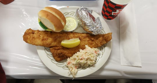 The popular fish fry at the Fairville Volunteer Fire Department comes with cole slaw, baked potato, roll, apple sauce, tarter sauce and lemon. Not pictured are the milk and ice cream that come with the meal.