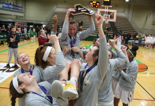 Pittsford Mendon players hold up teammate Danielle Strauf as they celebrate their state championship after defeating Seton Catholic 59-50 in the girls Class A state championship game at Hudson Valley Community College in Troy March 17, 2019.