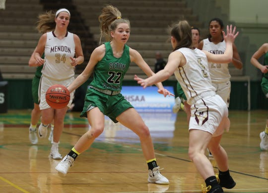 Seton Catholic's Reese Vaughn (22) drives to the basket in front of Mendon's Courtney Naugle (5) during the girls Class A state championship game at Hudson Valley Community College in Troy March 17, 2019.