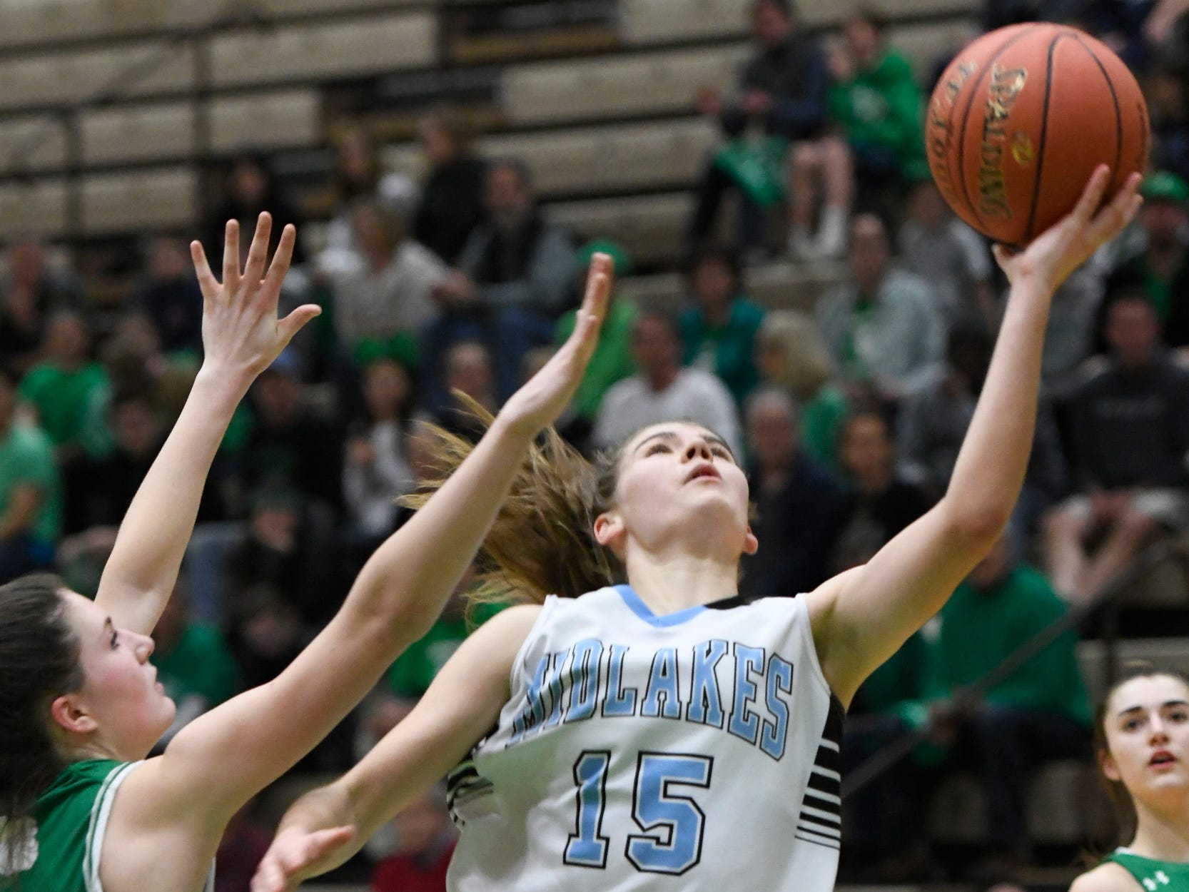 Midlakes' Cara Walker goes in for a layup during the Class B State Championship at Hudson Valley Community College on March 16, 2019, in Troy, N.Y.