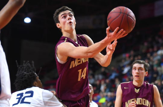 Pittsford Mendon's Dan Cook takes the ball to the basket against Poughkeepsie in the state Class A final.