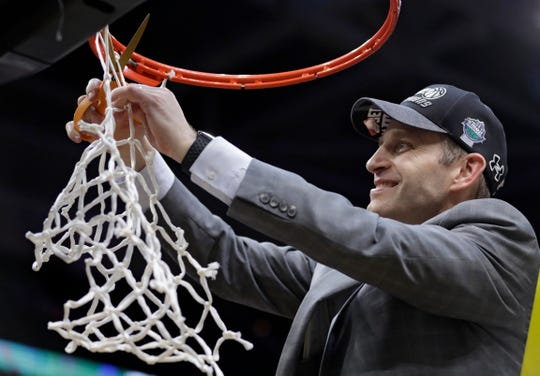 Buffalo coach Nate Oats cuts the net after Buffalo defeated Bowling Green 87-73 in an NCAA college basketball game for the Mid-American Conference men's tournament championship Saturday, March 16, 2019, in Cleveland.