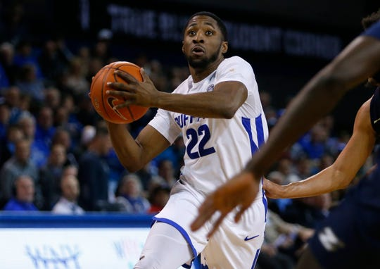 Buffalo guard Dontay Caruthers (22) looks to shoot against Akron during the second half of an NCAA college basketball game, Tuesday, Feb. 26, 2019, in Buffalo N.Y.