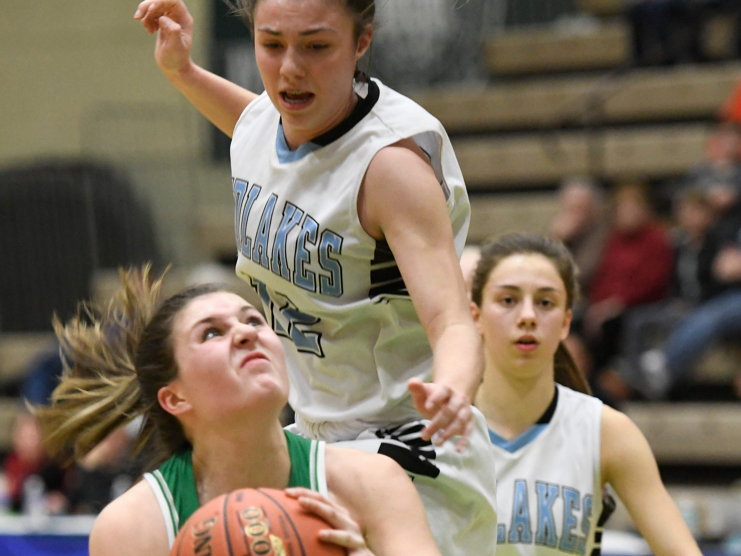 Midlakes' Alaina Forbes tries to block Irvington's Mia Mascone during the Class B State Championship at Hudson Valley Community College on March 16, 2019, in Troy, N.Y.