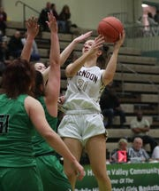 Mendon's Alana Fursman (21) puts up a shot in front of Seton Catholic's Marina Maerkl (24) during the girls Class A state championship game at Hudson Valley Community College in Troy March 17, 2019.