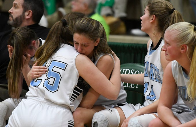 Midlakes girls basketball players console each other as they fall into a 30-point deficit against Irvington during the Class B State Championship at Hudson Valley Community College on March 16, 2019, in Troy, N.Y.