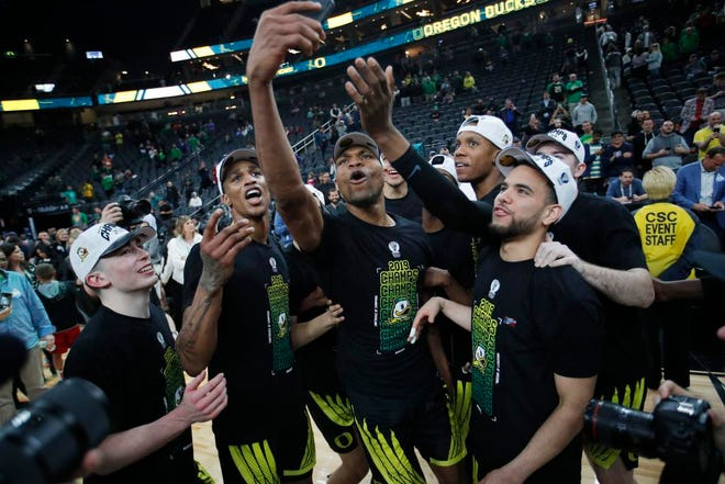Oregon players celebrate after defeating Washington 68-48 in an NCAA college basketball game in the final of the Pac-12 men's tournament Saturday, March 16, 2019, in Las Vegas. (AP Photo/John Locher)