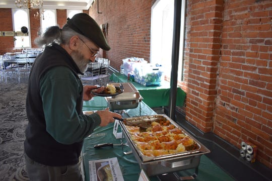 Gary Licata, 67, of Salem, piles his plate with some Irish shepherd's pie at the Sisters Irish Bistro's St. Patrick's Day celebration in the Trinity Ballroom at the Reed Opera House in 2019.