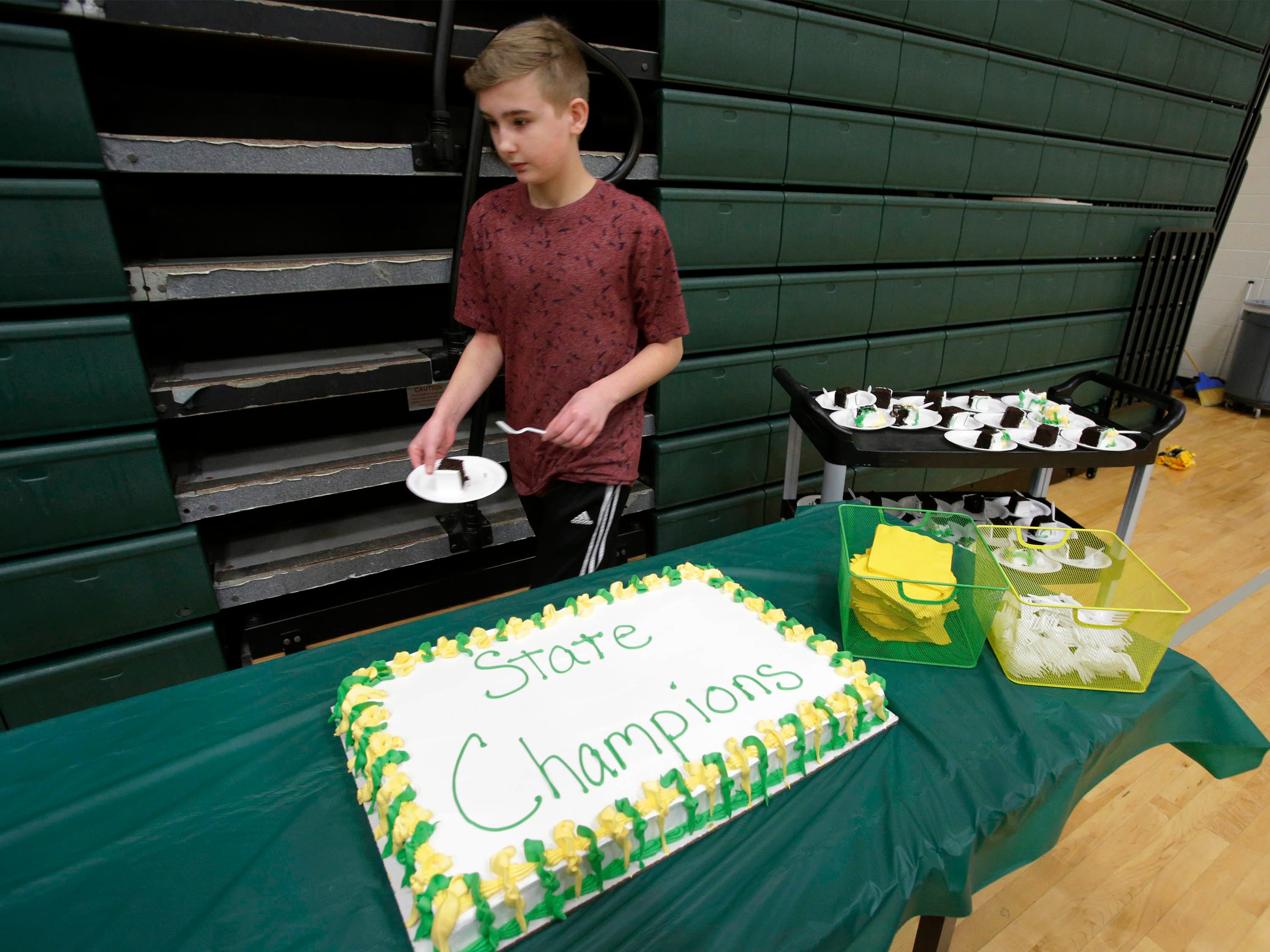 Cake was served following the Sheboygan Lutheran WIAA Div. 5 State Championship rally, Sunday, March 17, 2019, in Sheboygan, Wis.
