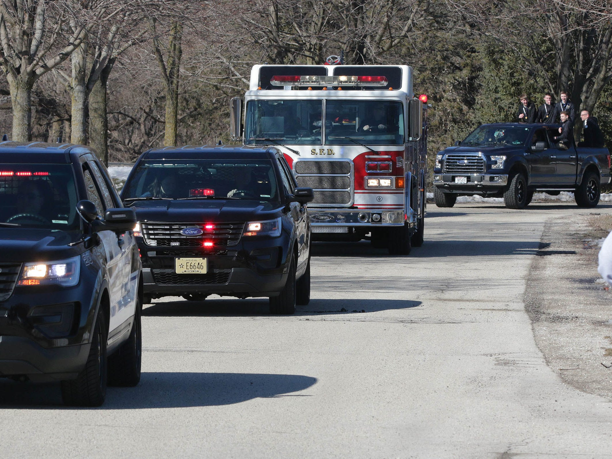 Police and fire vehicles escort the WIAA Div. 5 State Champions back to Sheboygan Lutheran High School, Sunday, March 17, 2019, in Sheboygan, Wis.
