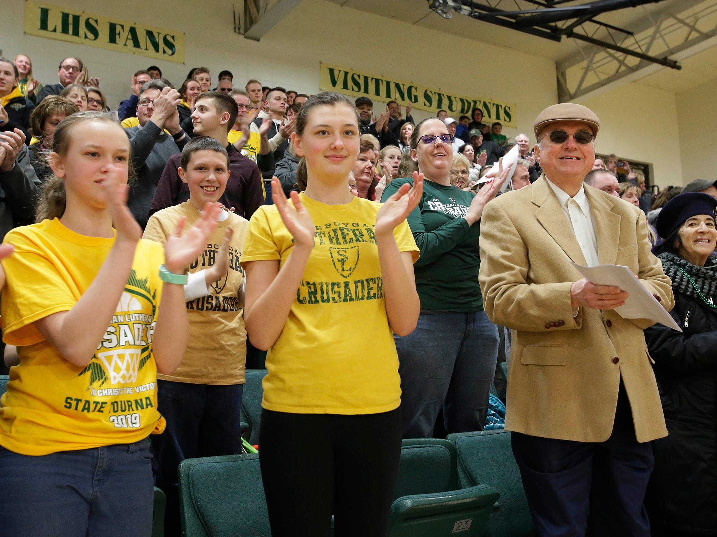 Sheboygan Lutheran fans of all ages applaud the boy's team WIAA Div. 5 Championship at a rally, Sunday, March 17, 2019, in Sheboygan, Wis.
