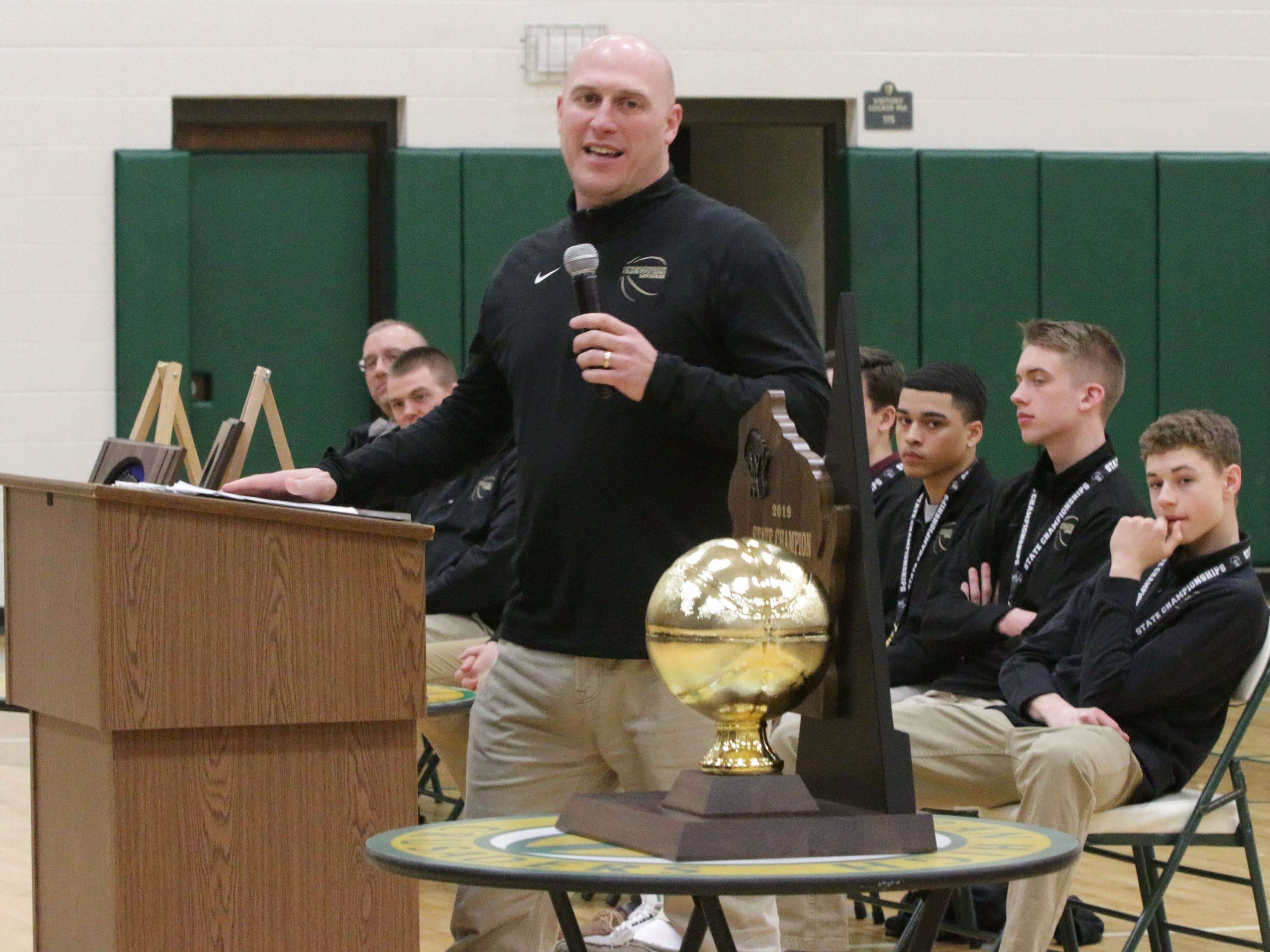 Sheboygan Lutheran basketball coach Nick Verhagen, left, speaks during the WIAA Div. 5 State Championship rally, Sunday, March 17, 2019, in Sheboygan, Wis.