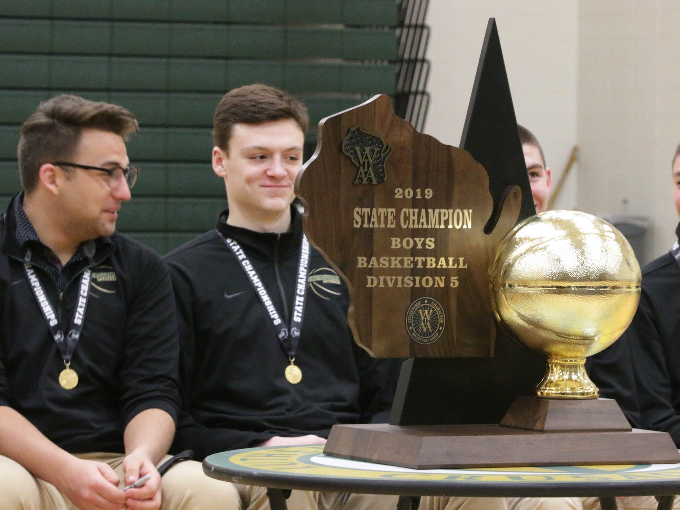 Sheboygan Lutheran players smile during the rally honoring the team for becoming the 2019 WIAA Div. 5 State Champions, Sunday, March 17, 2019, in Sheboygan, Wis.