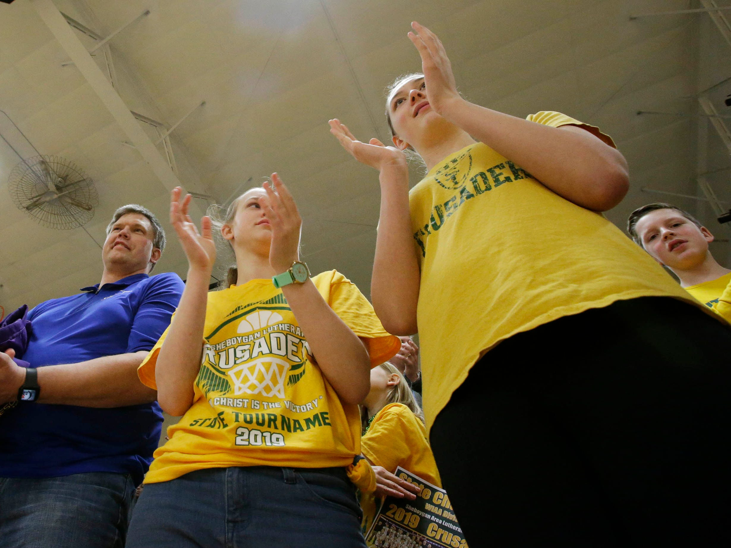 Sheboygan Lutheran fans applaud during the Championship rally, Sunday, March 17, 2019, in Sheboygan, Wis.