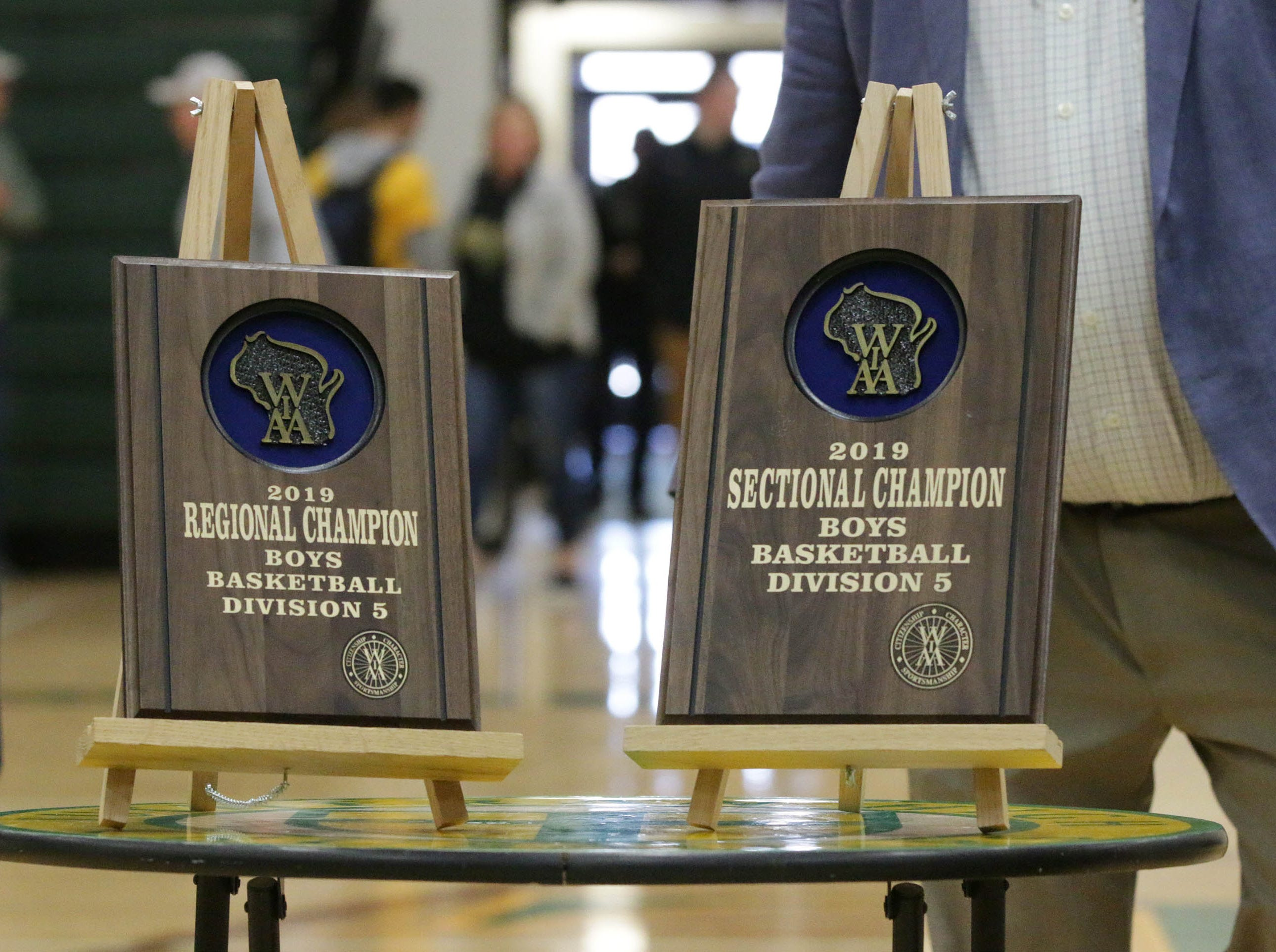 Trophies from the other championships that the Sheboygan Lutheran boys basketball team got on their way to state as seen at a rally, Sunday, March 17, 2019, in Sheboygan, Wis.