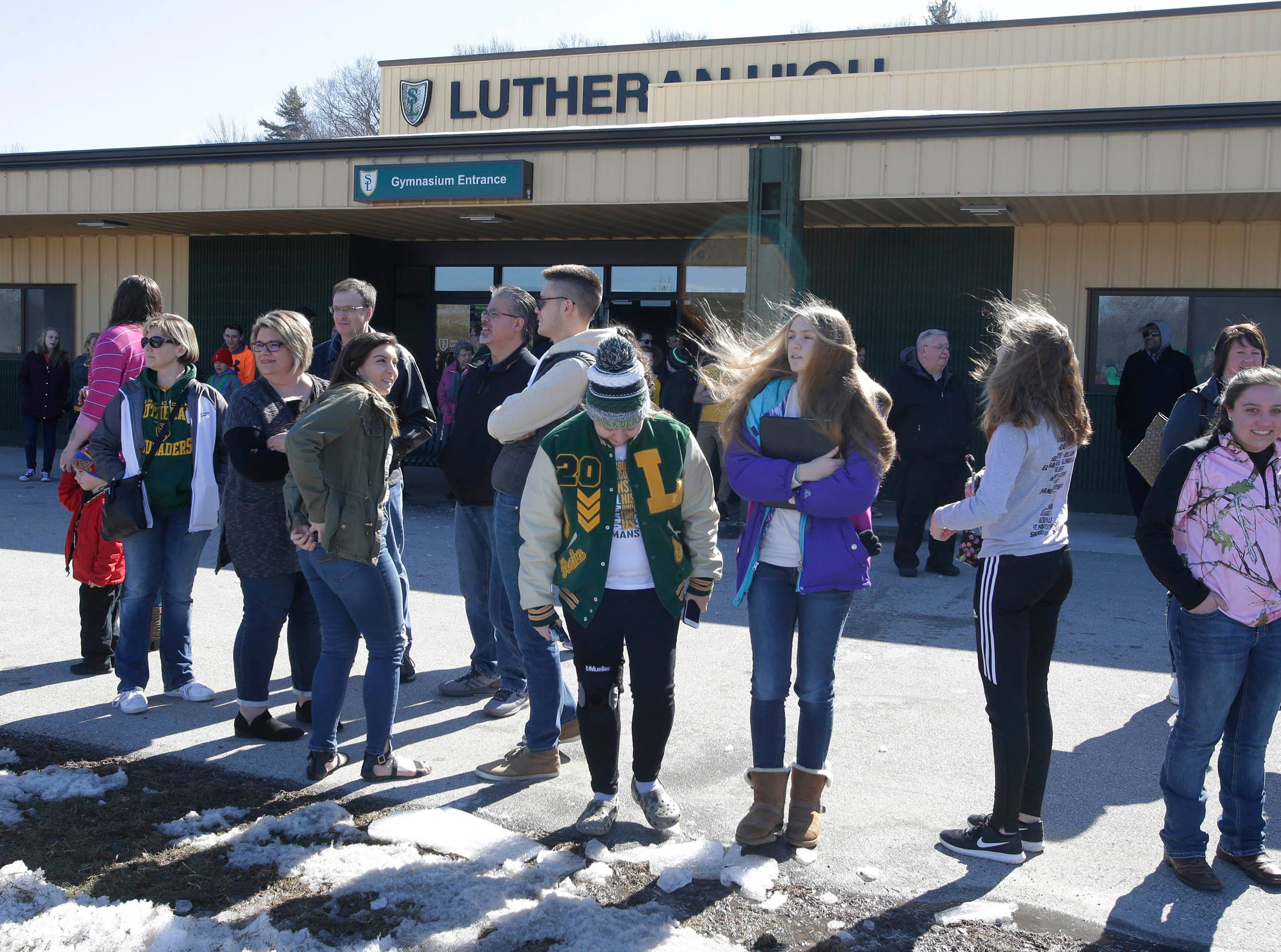 Sheboygan Lutheran fans wait outside the school for a rally celebrating the boys basketball team's WIAA Div. 5 State Championship, Sunday, March 17, 2019, in Sheboygan, Wis.