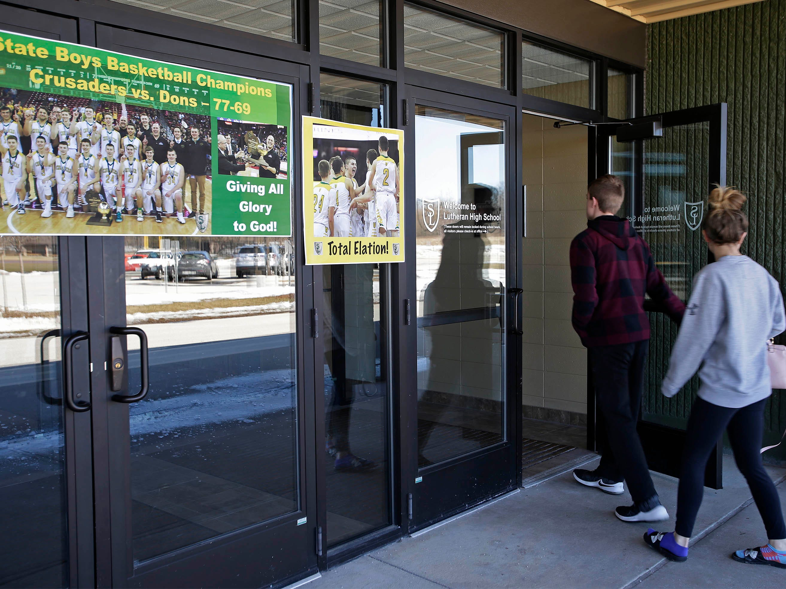 Sheboygan Lutheran fans enter the school for a rally celebrating the boys basketball team's WIAA Div. 5 State Championship, Sunday, March 17, 2019, in Sheboygan, Wis.