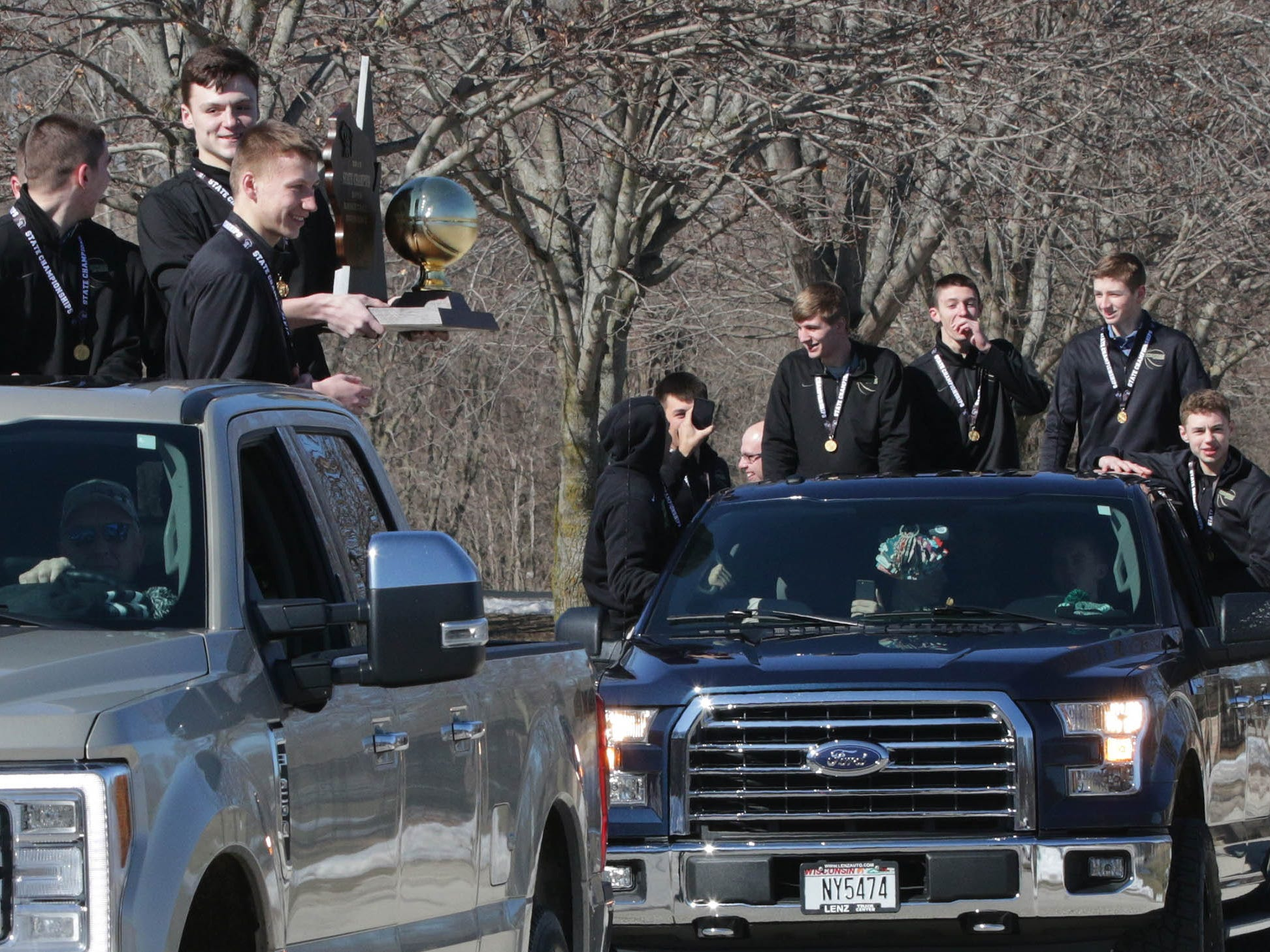 Sheboygan Lutheran basketball players arrive for a rally celebrating their WIAA Div. 5 State Champions win, Sunday, March 17, 2019, in Sheboygan, Wis.