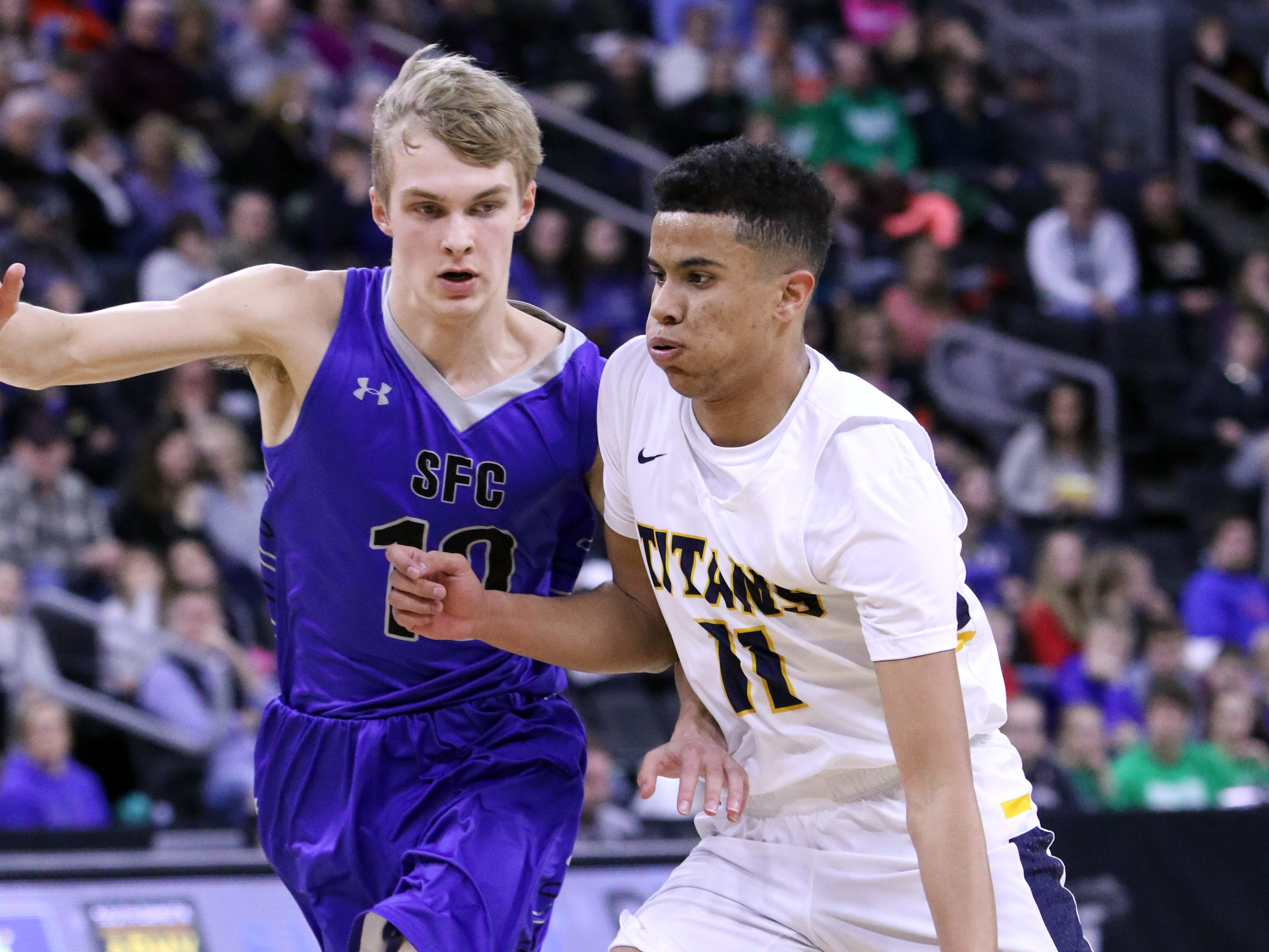 Justin Hohnr of Tea Area gets pressure from Mitchell Oostra of Sioux Falls Christian during Saturday's Class A title game at the Premier Center.