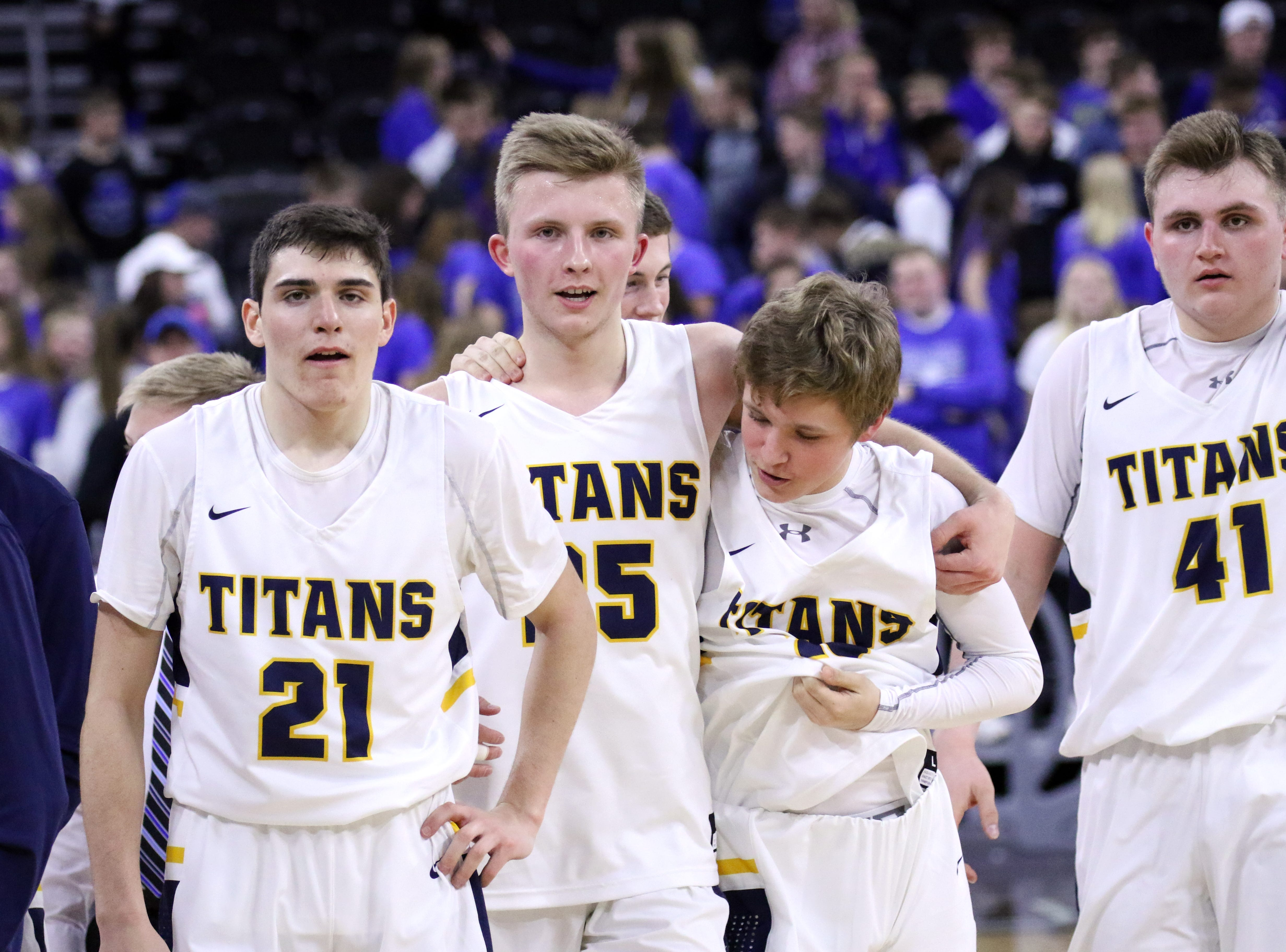 Tea Area players congratulate each other after defeating Sioux Falls Christian for the Class A title on Saturday night at the Premier Center.
