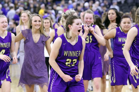 Bella Swedlund of Winner celebrates with her teammates after defeating West Central for the Class A title at the Premier Center in Sioux Falls.