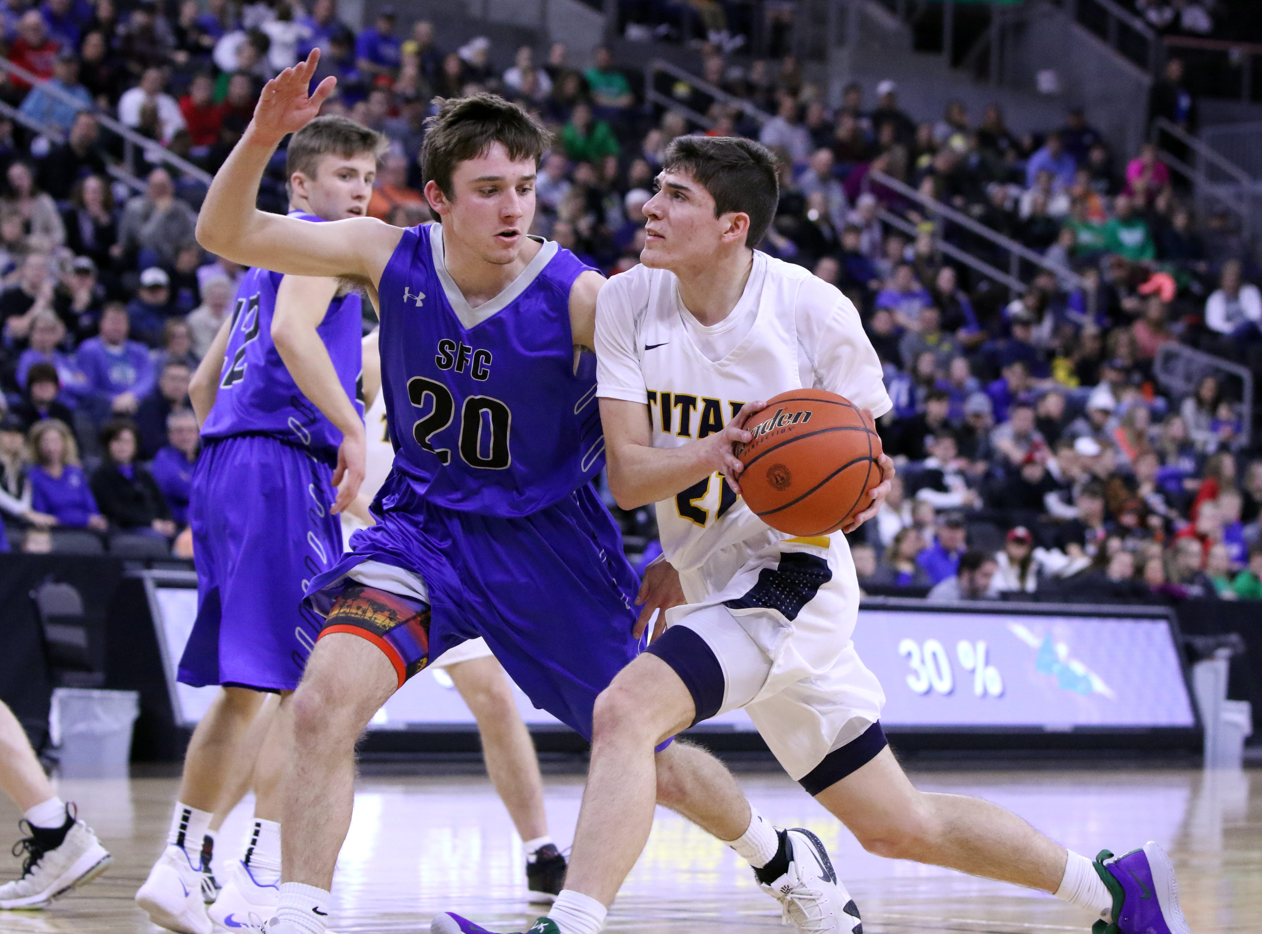 Kade Stearns of Tea Area drives against the defense by Parker Nelson of Sioux Falls Christian during Saturday's Class A title game at the Premier Center.