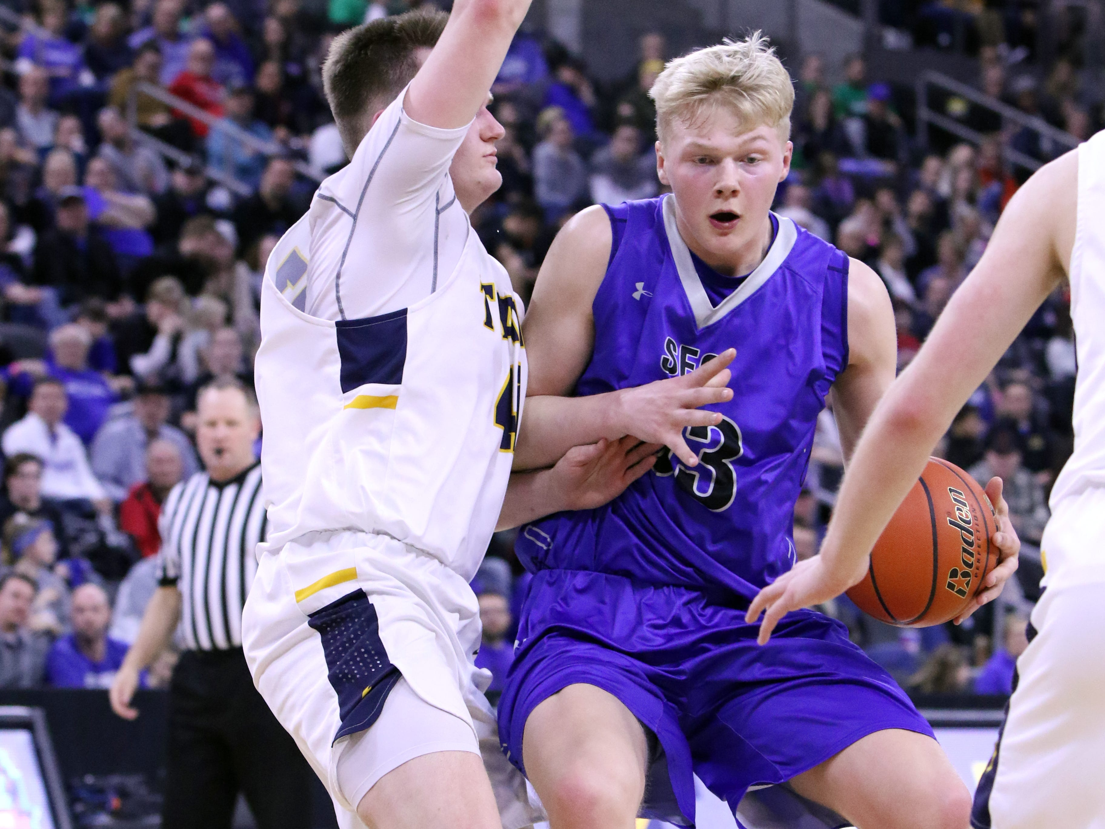 Zach Witte of Sioux Falls Christian battles against Kaleb Joffer of Tea Area during Saturday's Class A title game at the Premier Center.